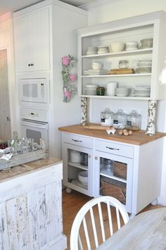 The rustic with the white cupboards