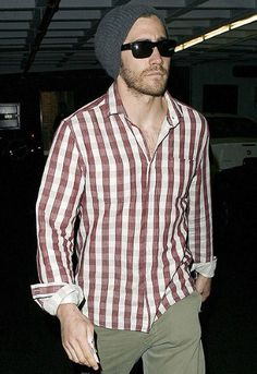 Jake Gyllenhaal doesn't look too cold with his slouchy grey beanie and checked shirt