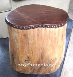Anythingology - Man Cave Reveal - wood stump with leather top affixed with upholstery tacks.