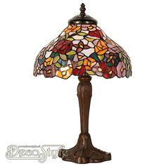Tiffany Tafellamp Flower  Een bijzonder mooie tafellamp. Helemaal met de hand gemaakt van echt Tiffanyglas. Dit originele glas zorgt voor de warme uitstraling. De voet is vervaardigd van bronskleurig ijzer. Met 1x klein fitting (E14). Met schakelaar aan het stroomsnoer. Afmetingen: Hoogte: 40 cm Diameter: 26 cm