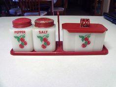 Vintage McKee Tipp Cherries Range Set Salt, Pepper, Grease Jar Davison Davison Bowers the set is still available.
