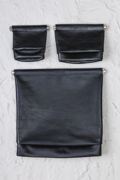 CARLY DAVID LEATHER CLUTCHES