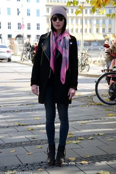 love the pop of pink softness over the leather jacket