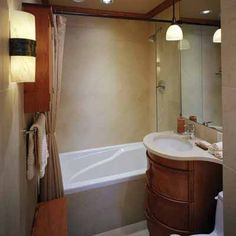 """Small Bathroom Ideas: These homeowners wanted to """"keep it simple and do it well."""" This cherry and limestone bath replaced a tiny, cluttered space meant for guest use. The curved-front vanity maximizes usable space with two deep drawers on double extension"""