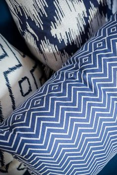 A bold mix of patterned pillows adds trendy style to the space but keeps with the overall blue theme.