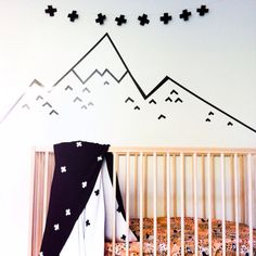 Black Washi tape wall decal with Scandi cross garland. Beautiful black and white Jamie Kay blanket and leopard kip and co cot sheet