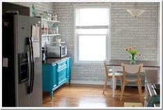 Pretty white kitchen w/ teal dresser and open shelves, Ikea Domsjo double farmhouse sink and butcher block countertops