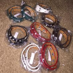 Wrap bracelets Faux leather wrap bracelets in white,red, green, brown, and black. Never worn or opened! There are 9 of them. Jewelry Bracelets