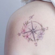 Elegant floral compass tattoo by Mini Lau