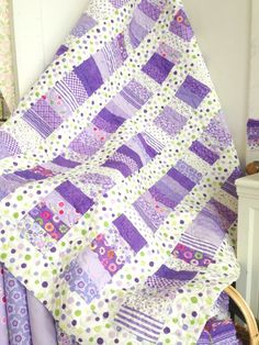 Purple Strip Quilt. I could do this! I love how easy it'd be to make but still have a great impact!