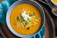 Pumpkin and Chickpea Soup with sour cream. This hearty soup is even more irresistible with Mexican spices and a cheesy topping.