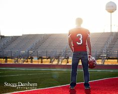 Cool senior pic idea except I'd have him move his hand away from his crotch.