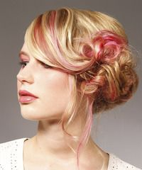 This dainty 'do is worn over to one side and pinned to the head to create this lavish look which is best suited for those with long face shapes and fine to medium hair types. A splash of color is added to enhance the over-all look and completes it perfectly.