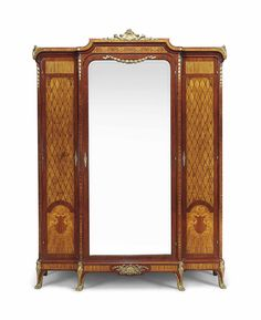 A FRENCH GILT-BRONZE MOUNTED MAHOGANY AND SATINWOOD ARMOIRE -  OF LOUIS XVI STYLE, LATE 19TH CENTURY