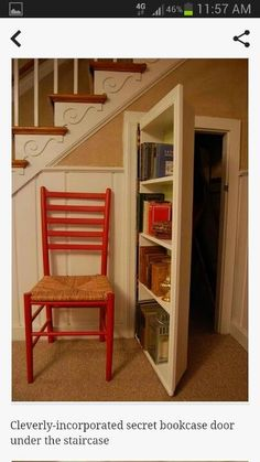 Bookcase serves as hidden door for storage under the stairs.