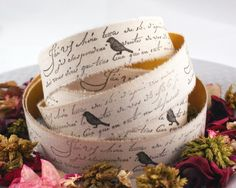 hand-stamped french script fabric tape. This would look cute as fabric, then stamp birds;)