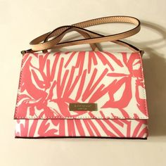 """Kate Spade 'Grant Street' Sally Small Cross body Kate Spade New York 'Grant Street' Sally Small Crossbody. Color Pnyplmorcd (573).  Small crossbody with magnetic closure. Palm printed grainy vinyl trimmed in leather. KS New York light gold staple. Lined with interior and slide pocket.  Dimensions:  8""""x 5"""" x 1"""" (LxHxD) with a 20"""" strap drop.   Does not come with a duster. Brand new with tags and never used.  Retail $125.00 kate spade Bags Crossbody Bags"""