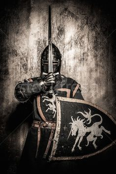 Medieval knight  holding sword in front of his face stock photo (c) Nejron (#4617816) | Stockfresh