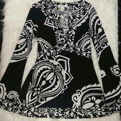 """White House Black Market Top This stunning top is 25.5"""" long from shoulders. Has under chest tie for adjustable comfort. A V cut in front & is in like new condition. Arm have flare at ends giving added dramatic increase to this AMAZING top! Tag is xs, but small. Could wear too. White House Black Market Tops Blouses"""