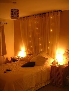 Hang a curtain behind a bed with string lights -