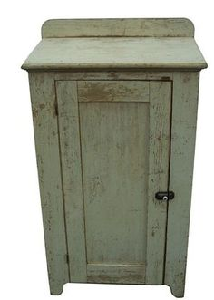 "Mid 19th century Lancaster County,Pennsylvania one door Milk Cupboard, in original off white paint single paneled door mortised, nice high cut out foot , solid end boards , with applied back splash, natural patina on the inside circa 1850 49 1/2"" tall x 28"" wide x19"" deep"