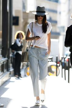 Kendall Jenner wearing Rag & Bone Floppy Brim Fedora, Miu Miu Metal Cap Toe Sneakers and Celine Nano Bag.