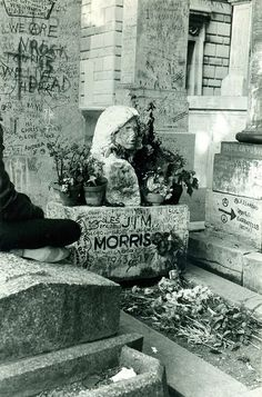 Père Lachaise Cemetery    This is a scanned photo of Jim Morrison's grave taken in 1985.The bust has since been stolen and replaced with a rectangular headstone.
