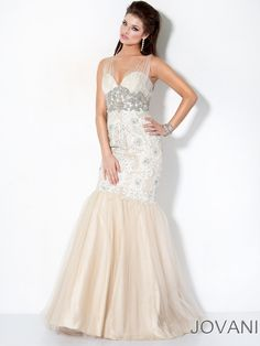 Sophisticated tulle/lace prom evening dress Jovani 158908. Once you find the one, you will never look back and this dress turns out to be the love of your life!!!. Delicate ruched straps, made out of diaphanous tulle, overlay the sweetheart neck. At the empire waist a great pattern of beads and swirls add luxury to the dress. The fitted bodice is exquisitely accented by lace and embroidery details. Meanwhile, the mermaid skirt has a tulle overlay. Available in Black. Nude and Off-White/Nude…