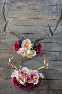 A chic rustic deer antler decor with flower crown. Perfect for a family room or little girls room.