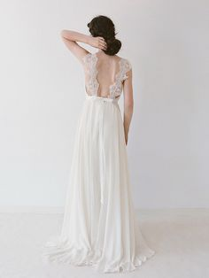 Your Dream Bridal // truvelle - A chiffon wedding gown with an open back featuring vintage lace straps. http://www.yourdreambridal.com/