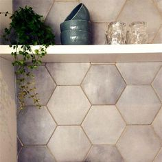 Calling all glam lovers out there this is a dream come true. GOLD GROUT for your home!! Let's start with your kitchen. Hex tiles are my favorite. Just like this beautiful tile design from Pinterest. The geometric shape of the tile adds interest in your space. Partner it with gold grout and you've got an instant Glam kitchen