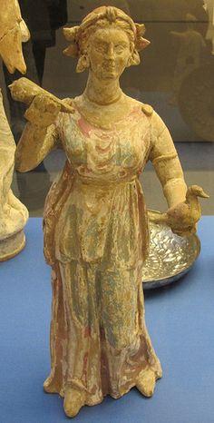 Canosa, statuetta di una donna con anatra e conchiglia, 270-200 CE   by saamiblog