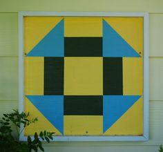 Churn dash quilt block on barn