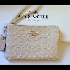 """Coach Signature PT Leather Corner Zip Wristlet Coach Signature DBS Patent Leather Corner Zip Wristlet   ~ Signature Patent Leather  ~ Chalk White Patient Leather Strap & Hangtag/ Gold-Tone Hardware  ~ 2 inside slip pockets for credit/bank card ~ 6 1/4"""" x 4"""" New with tags , care card & gift box.  No Trades No Holds Coach Bags Clutches & Wristlets"""