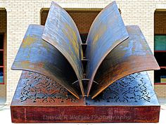This metal book sculpture is in front of the Fairhope, AL library. Its about 10 feet (3 meters) wide.