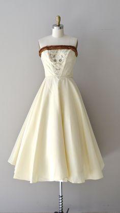 Vintage 1950s warm cream faille wedding dress with mink trim, silver bead and rhinestone bodice with boned interior