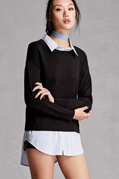 A mixed media top featuring a woven pinstripe mock shirt underlay with a buttoned  basic collar and a high-low hem with a split front, and a knit sweater with a round neckline and dropped long sleeves with ribbed cuffs.