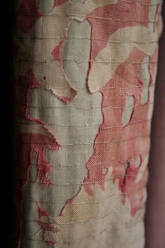 Conservation stitching in light-damaged curtain. Rows of stitch on fabric.  by ruthsinger, via Flickr