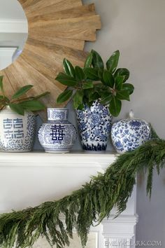 Christmas mantel decorating, blue and white, garland, sunburst mirror