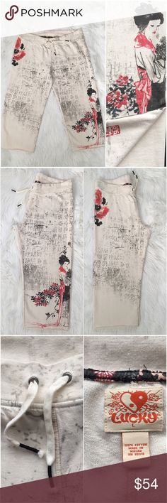 """LUCKY BRAND Geisha Cherry Blossom Cropped Pants Lucky Brand Geisha Girl Cherry Blossom  Cropped Sweat/Lounge Pants. A very delicate Asian themed graphic design. Looks like a beautiful watercolor painting. Size: L Color: Ivory, Red, Pink, Black Adjustable drawstring waist.  Approx Measurements: (Taken on a flat surface) Length: 32"""" (L) / From top of waist (on back of pants) to bottom hem.  Inseam: 22"""" (L) Rise: 10"""" (L) Waist: 18.5"""" (W) / Untied Bottom of leg opening: 9.5 (W) In great…"""
