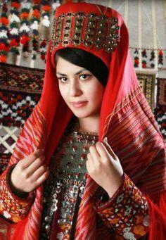 Turkmen girl in traditional dress.