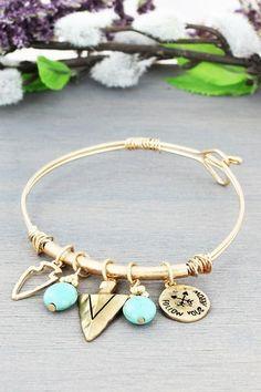 Stylish Arrowhead themed charm bracelet that will go with any outfit. Worn Goldtone Arrowhead and Turquoise Charm Wire Bracelet #ewamboutique #followyourarrow #bohojewelry #bohochic