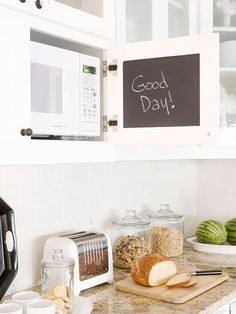Cool idea to do a chalkboard or chalkboard paint inside a kitchen cabinet! Fantastic kitchen with built-in microwave cabinet with black chalkboard interior cabinet door. Built In Microwave Cabinet, Hidden Microwave, Microwave In Kitchen, Kitchen Redo, New Kitchen, Kitchen Remodel, Under Counter Microwave, Hidden Kitchen, Cherry Kitchen