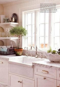 kitchen - love the white, the open shelving, sink I'd maybe have a higher front lip, love the taps too