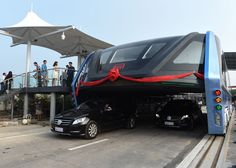 Traffic-straddling bus makes first test run on Chinese roads.