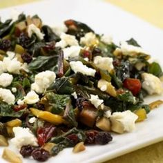 Tangy green olives, sweet currants and creamy goat cheese turn chard into a sophisticated treat.