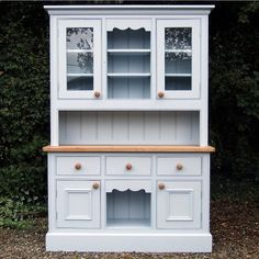 Shown here Hand-Painted in Farrow and Ball Parma Gray No.27  This Welsh dresser is hand made in solid pine using traditional methods of construction and styling. These include:-  T&G cabinet backs. Hand Dovetailed drawers. Beaded & mitred framing around doors and drawer fronts. Built to your own specifications and finished in any colour from the Farrow & Ball paint range.