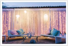 For this ocean in the desert Scottsdale wedding, Alchemy Fine Events created a jellyfish lounge with gorgeous twinkle lights and sheer drapery.   Event design by Alchemy Fine Events | www. alchemyfineevents.com