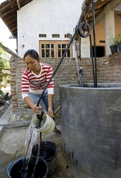 A woman living in the Rembang region of Java collects water froma well outside of her house. #WorldWaterDay