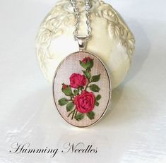 Just roses, more roses than words...        Roses on pendants,        on tiny ones        and bigger ones...        Roses on a ring        a...